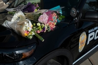 People brought flowers to the Boulder Police Department in honor of officer Eric Talley, who was killed while trying to protect others. MUST CREDIT: Photo by Rachel Woolf for The Washington Post