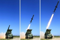 These photos published by the North's daily Rodong Sinmun on June 9, 2017, show the launch of the country's new surface-to-ship cruise missile. The report said the country's top leader Kim Jong-un observed the missile launch, which South Korea detected a day earlier. The North's media said the test-firing was aimed at verifying the