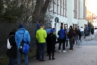 Visitors form a socially distanced queue to enter a covid-19 test center in Berlin on March 19, 2021. MUST CREDIT: Bloomberg photo by Liesa Johannssen-Koppitz.