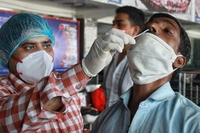 Health worker collects swab sample for Covid-19 testing at New Delhi Railway Station in new Delhi on Friday April 02, 2021. (Photo:Wasim Sarvar/IANS)