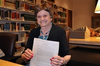 Wonder Woman writer Joye Hummel donated her archives to the Smithsonian Institution in 2014. In her hands is the psychology take-home exam that had drawn William Moulton Marston's attention. MUST CREDIT: Elizabeth O'Brien/Smithsonian Institution