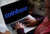 The Coinbase logo on a laptop computer arranged in Hastings-on-Hudson, N.Y., on Jan. 5, 2021. MUST CREDIT: Bloomberg photo by Tiffany Hagler-Geard