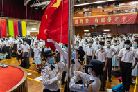 Students raise the Chinese national flag during a ceremony marking the National Security Education Day at a school in Hong Kong on April 15. MUST CREDIT: Bloomberg photo by Chan Long Hei.