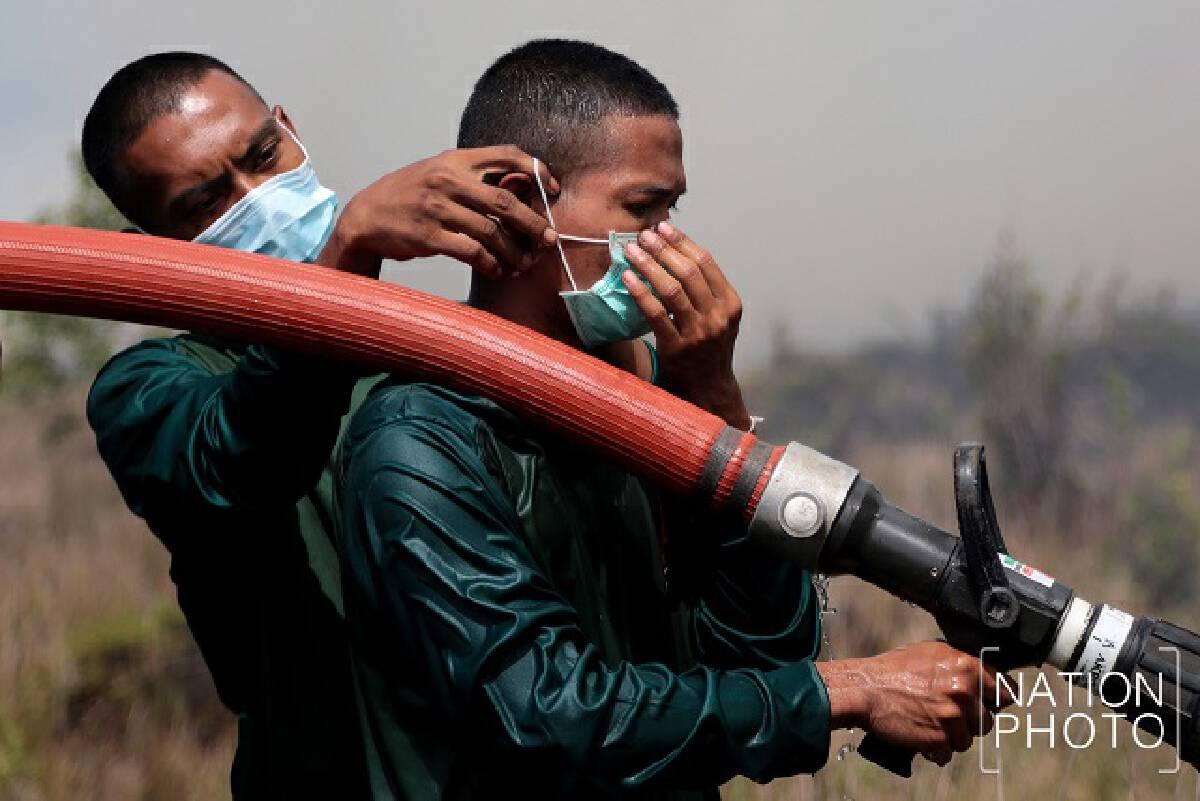 Khuan Khreng wildfire still smouldering as officials tackle smoke