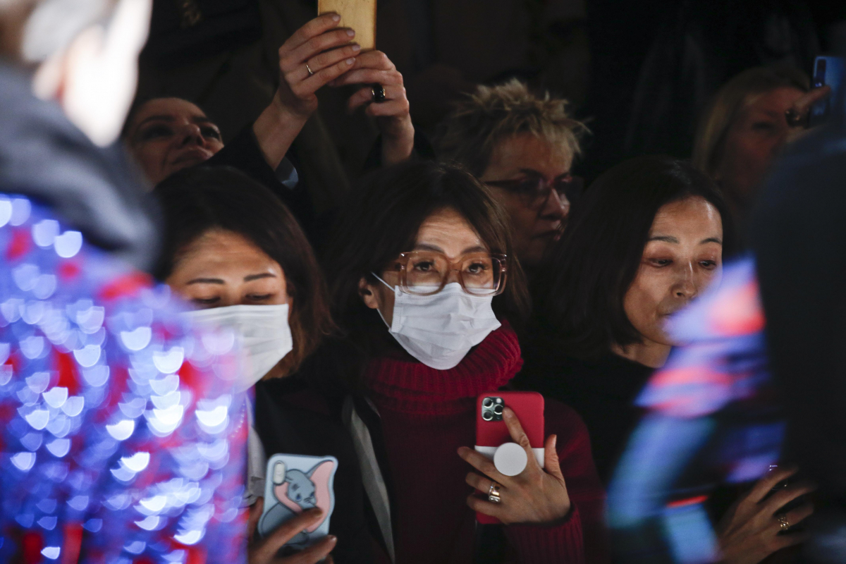 Some guests attending the Dries Van Noten fall/winter 20-21 fashion show wore face masks. MUST CREDIT: Photo by Stefan Knauer/MCV Photo for The Washington Post
