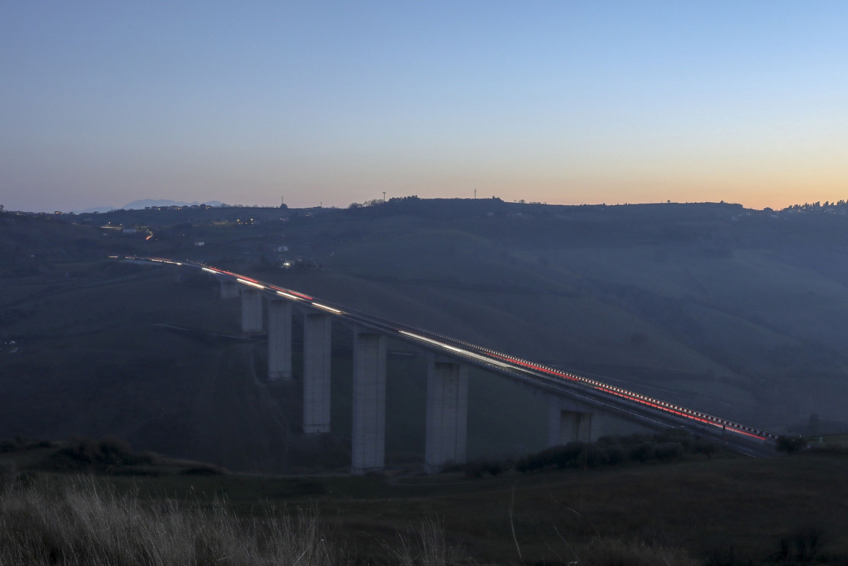 Light trails made by passing automobiles are seen along the Cerrano motorway bridge in Pineto, Italy, on Jan. 22, 2020. MUST CREDIT: Bloomberg photo by Alessia Pierdomenico.