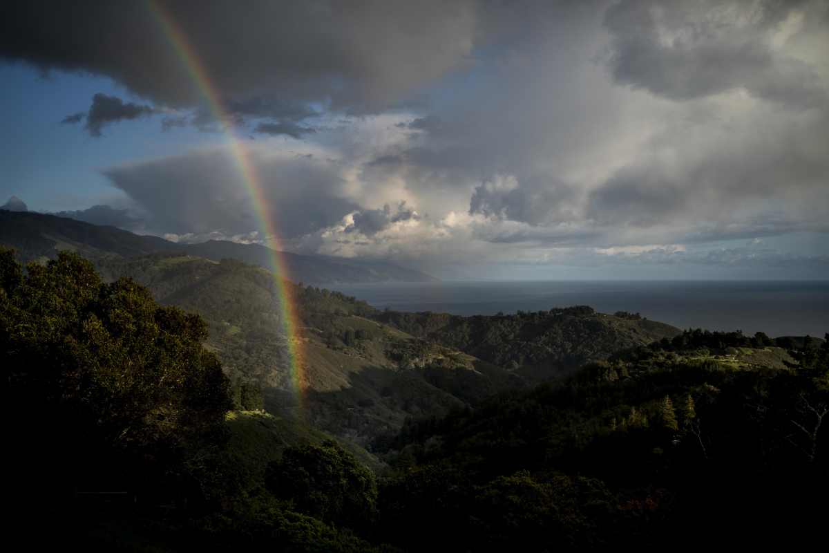 A rainbow appears along the Pacific Coast in Big Sur, Calif., during the coronavirus outbreak. MUST CREDIT: Washington Post photo by Melina Mara