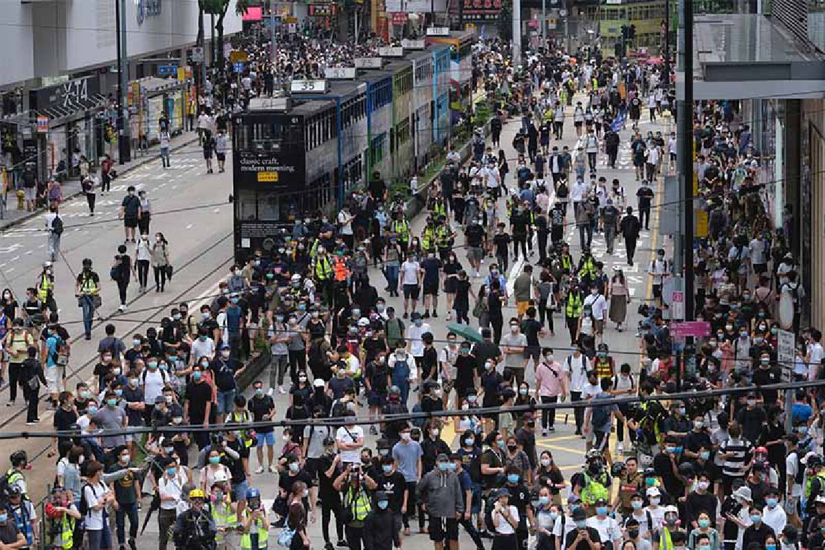 Demonstrators gather in the Causeway Bay district in Hong Kong on Sunday, May 24, 2020. MUST CREDIT: Bloomberg photo by Roy Liu