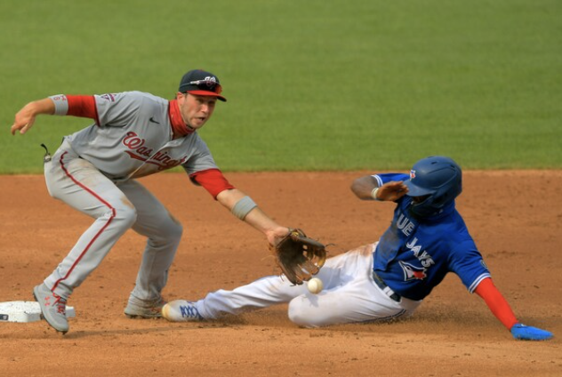 Teoscar Hernandez unsuccessfully slides toward second base on a steal attempt as Washington Nationals Carter Kieboom, playing the shift, gets the tag during the Nationals' defeat of the Toronto Blue Jays, 6-4, at Nationals Park on Thursday, July 30, 2020. MUST CREDIT: Washington Post photo by John McDonnell