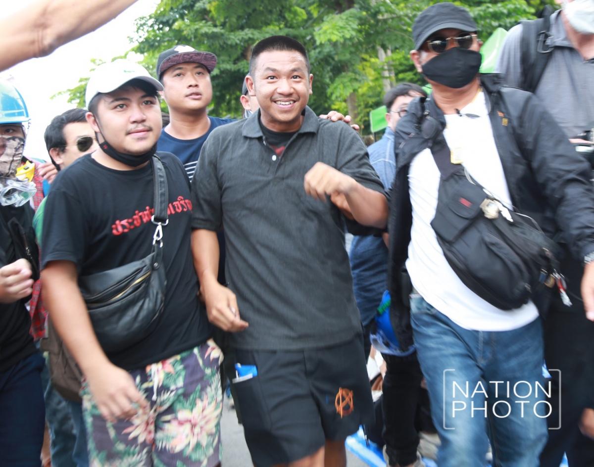 "Pro-democracy activist Jatupat ""Pai Dao Din"" Boonpatararaksa walks out of the Bangkok Remand Prison after the Appeal Court grants him bail on Friday."