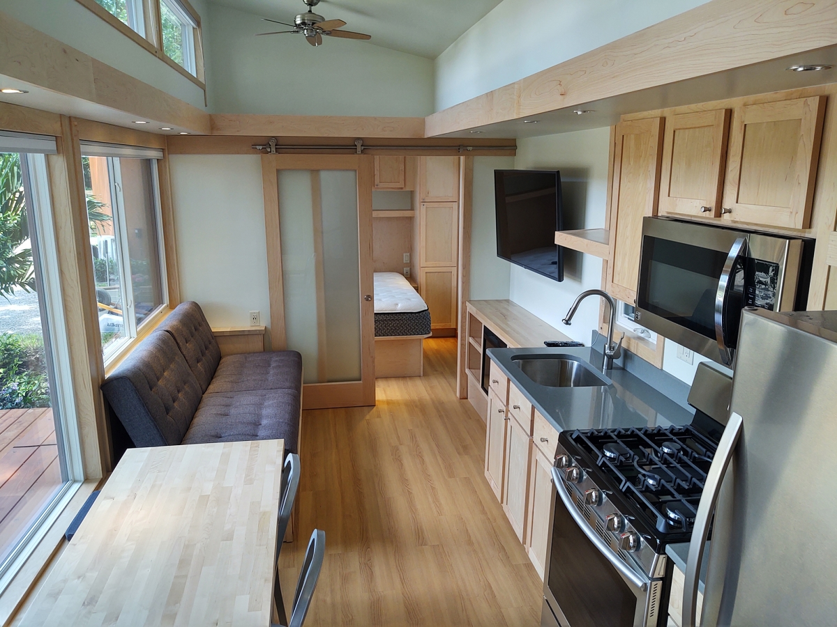 The kitchen in this tiny house in the community has full-size appliances. MUST CREDIT: David Peterson.