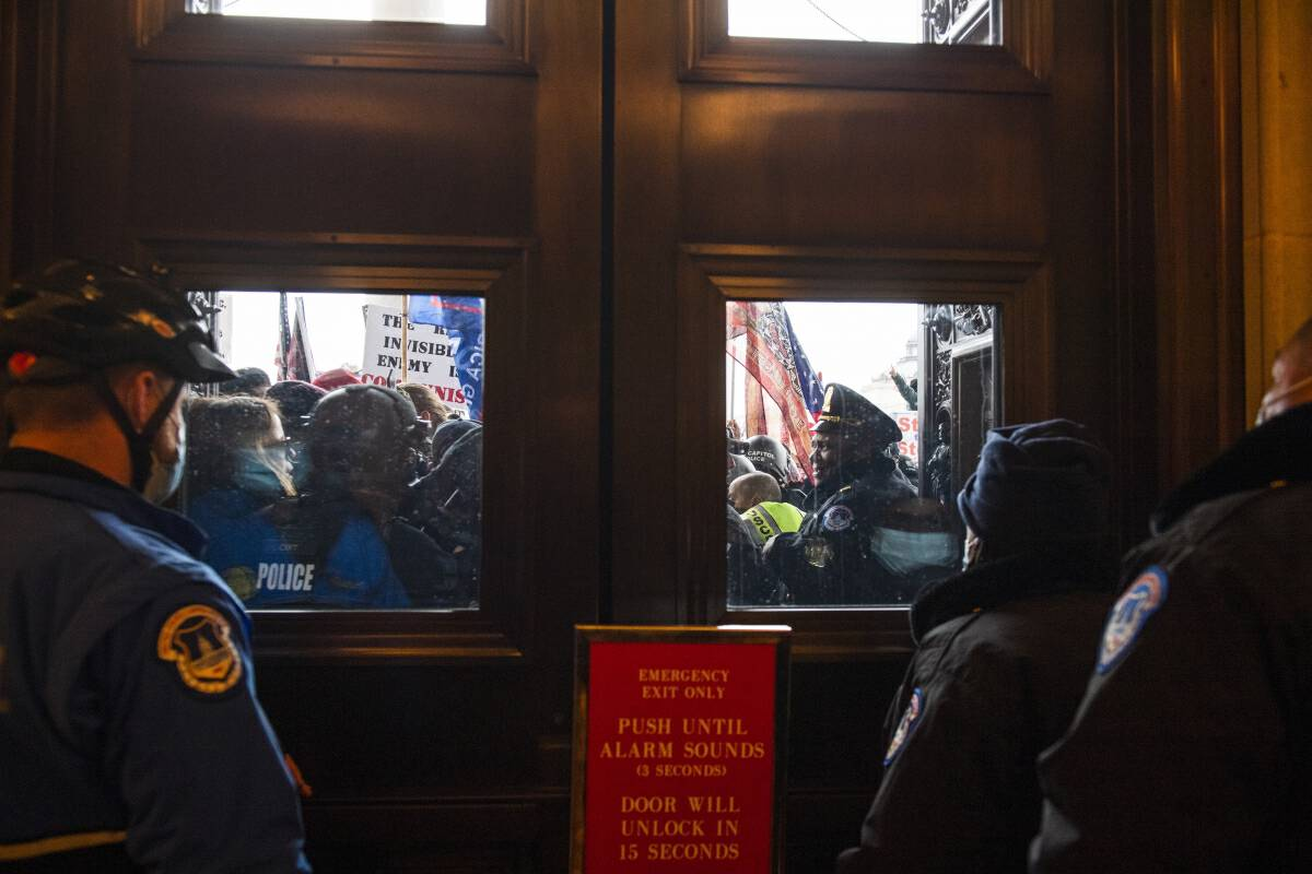 Rioters fight for access to the U.S. Capitol during a joint congressional session to certify the electoral college vote in Washington, D.C. on Jan. 6, 2021. MUST CREDIT: Photo for The Washington Post by Amanda Voisard