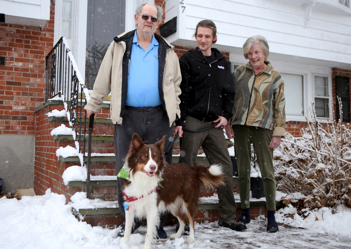 From left, Richard, Jonathan, and Christine Burlingame stand with their dog, Blaze, outside of Jonathan's home in Canton, Mass. MUST CREDIT: Photo for The Washington Post by Olivia Falcigno