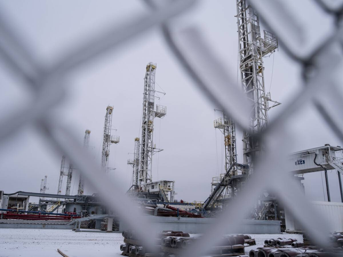 Idle oil drilling rigs in the snow at a lot near Midland, Texas,on Feb. 13, 2021. MUST CREDIT: Bloomberg photo by Matthew Busch