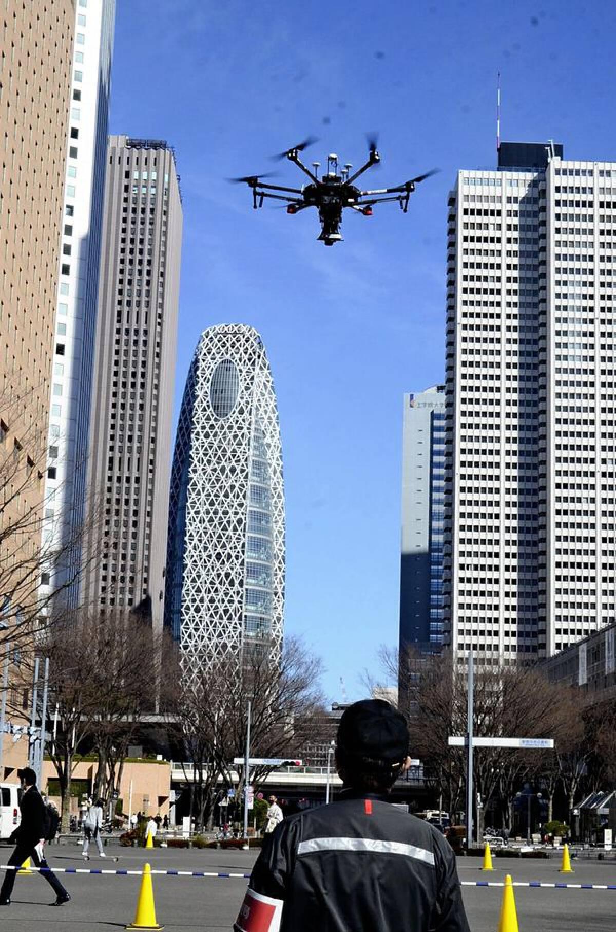 A drone flies near the Tokyo Metropolitan Government Office in Shinjuku Ward on Wednesday.