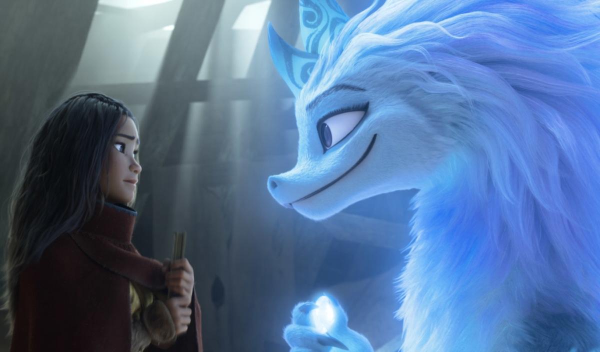 "Kelly Marie Tran as Raya, left, and Awkwafina as the dragon Sisu in ""Raya and the Last Dragon."" MUST CREDIT: Disney"