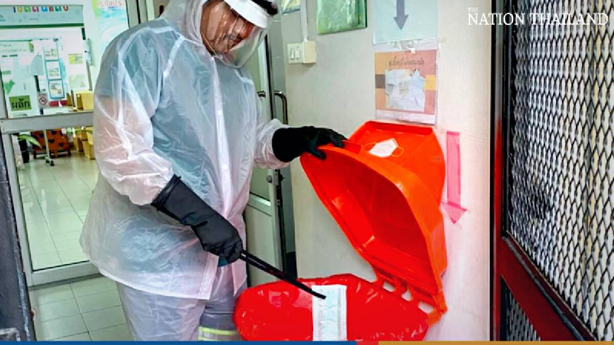 Bangkok deploys public biohazard bins to tackle daily mountain of used masks