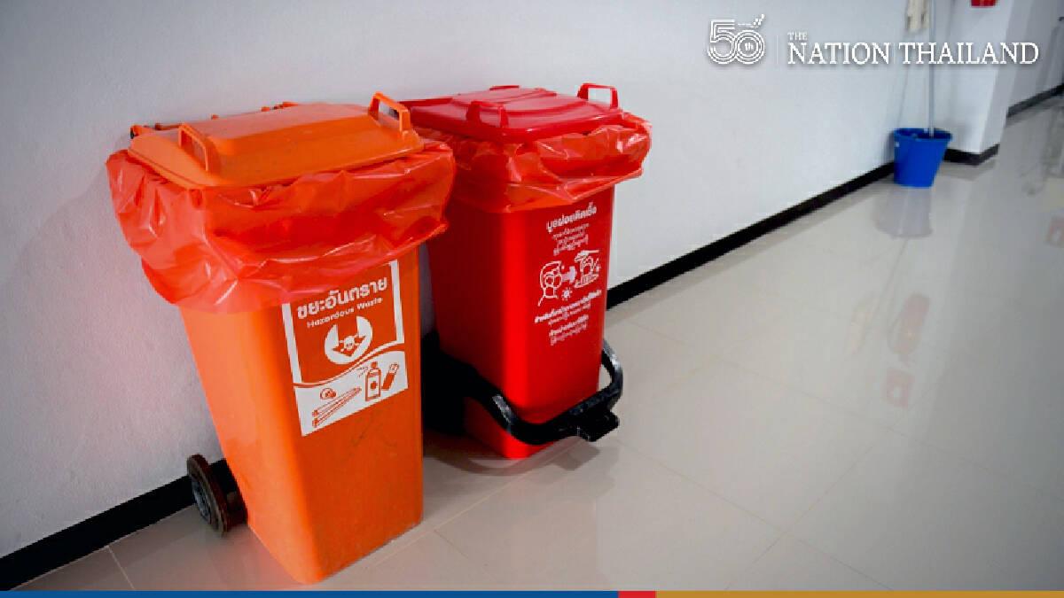 Orange bins mushroom in Bangkok as 3rd wave brings tide of used masks