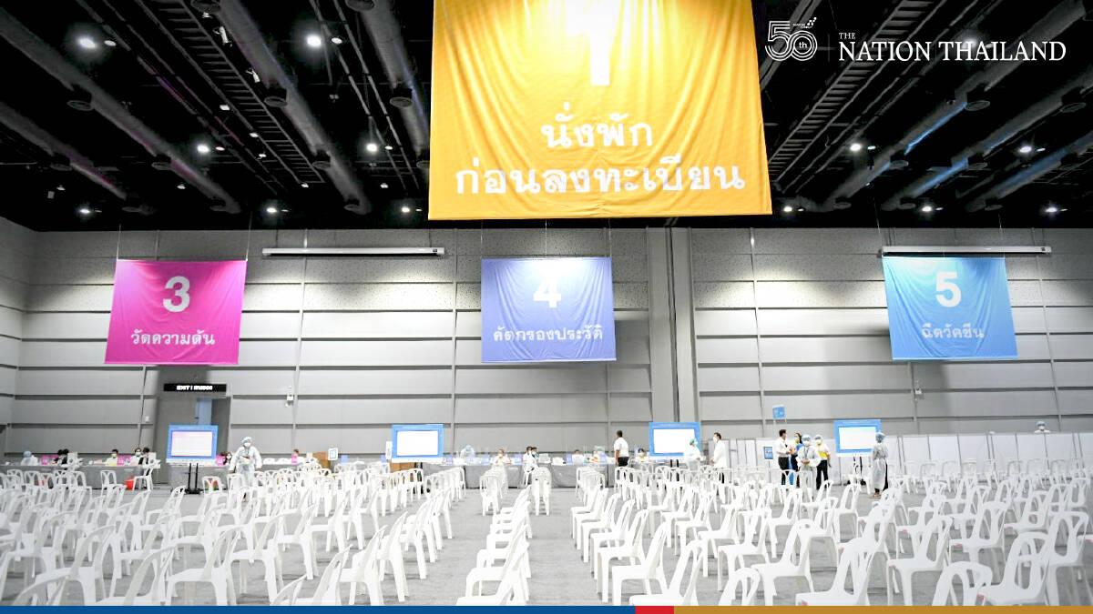 PM checks two more shop-and-jab stations in Bangkok malls