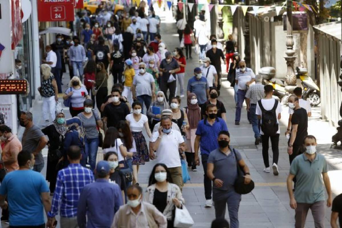 Pedestrians walk on a street in Ankara, Turkey, on July 1, 2021.