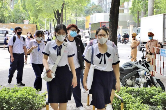 High school students leave a test site in southern Vietnam's Ho Chi Minh City, July 7, 2021.