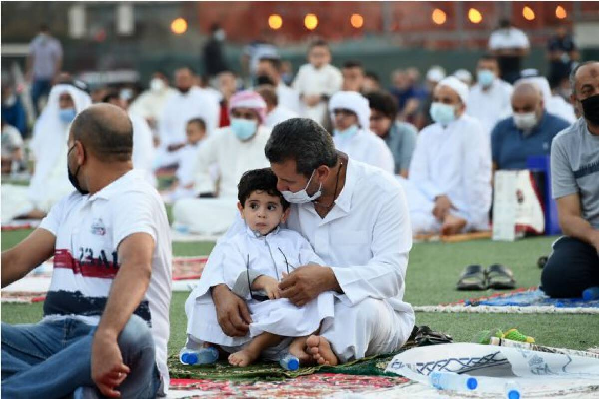 People perform prayers during Eid al-Adha holiday in Hawalli Governorate, Kuwait