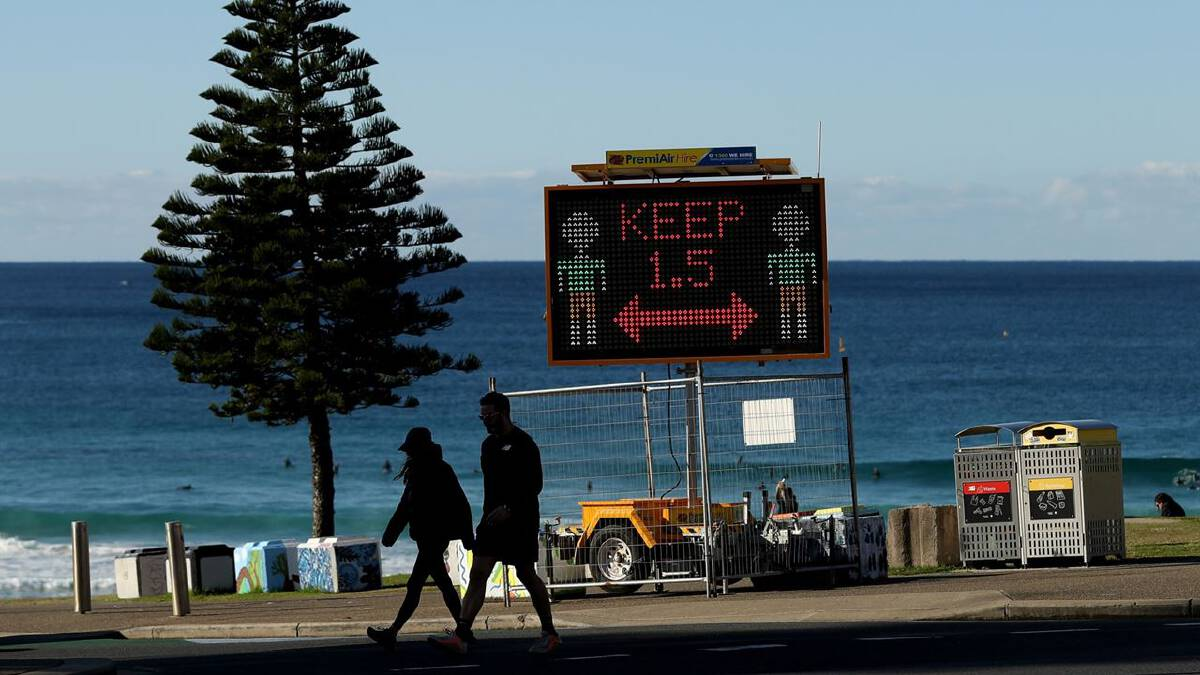 A Covid-19 public health order sign for social distancing on Bondi Beach in Sydney on July 4, 2021. MUST CREDIT: Bloomberg photo by Brendon Thorne.