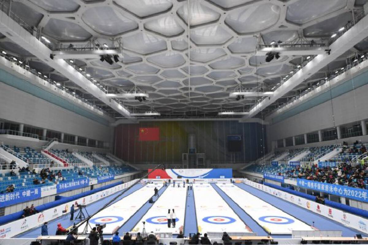 """The National Aquatics Center, locally known as """"Water Cube"""" has now transformed into the """"Ice Cube"""" with four Winter Olympics standard curling sheets."""