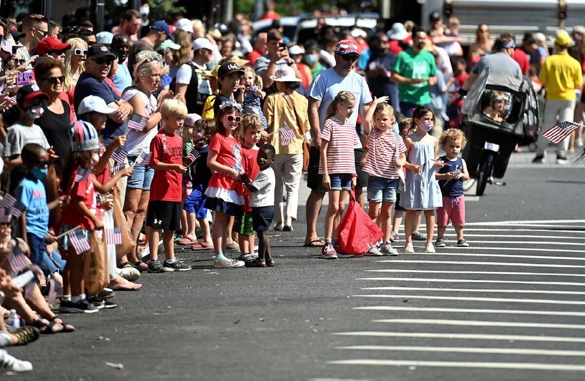 Spectators enjoy the Barracks Row Parade celebrating Independence Day in Washington, D.C., on July 4. MUST CREDIT: Washington Post photo by Marvin Joseph