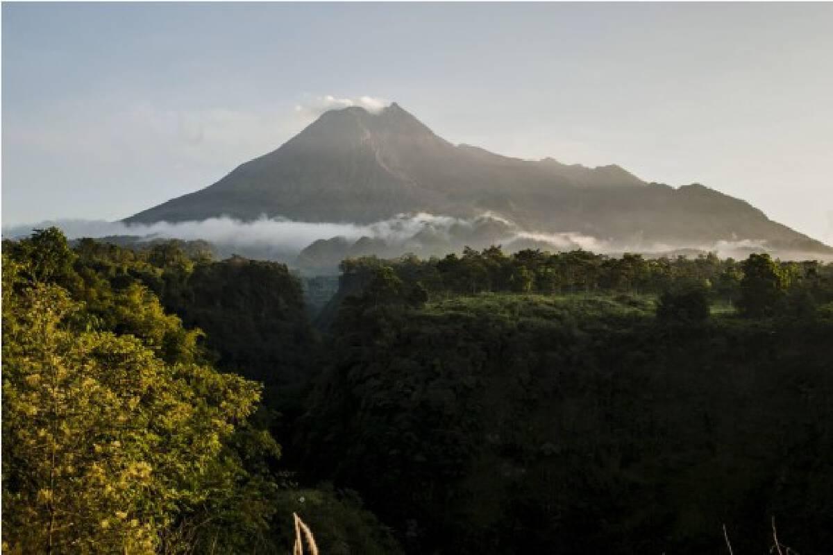 Photo taken on July 1, 2021 shows white smokes spewing from Mount Merapi, seen at Cangkringan village, Sleman district, Yogyakarta of Indonesia.