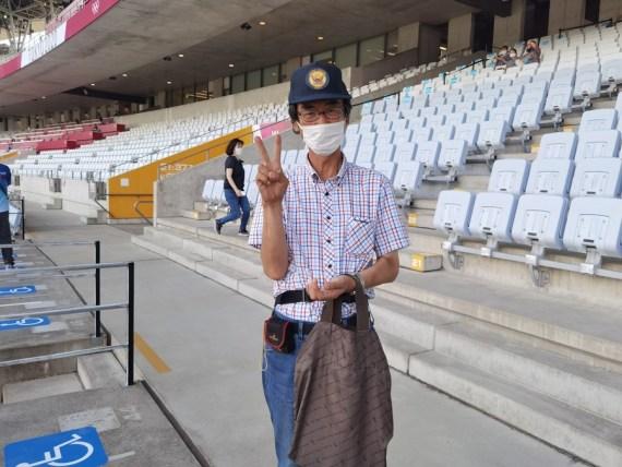 Spectator Masayuki Hobo posts for photos at the Miyagi Stadium before the Tokyo 2020 women's football match between China and Brazil in Miyagi, Japan