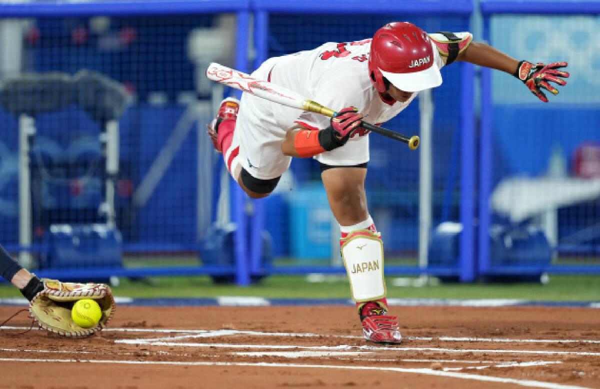 Naito Minori of Japan competes during the softball final between Japan and the United States at the Tokyo 2020 Olympic Games in Yokohama, Japan, July 27, 2021.
