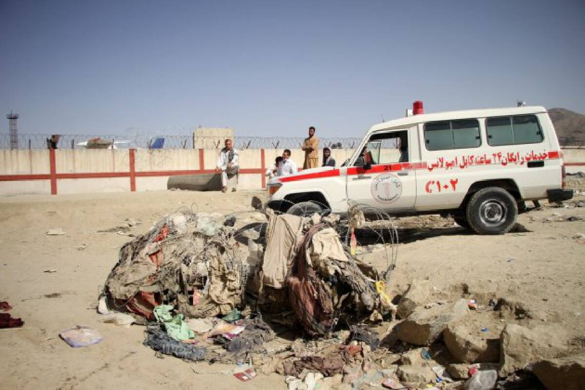 An ambulance is seen at the explosion site near the Kabul airport in Afghanistan, Aug. 27, 2021.