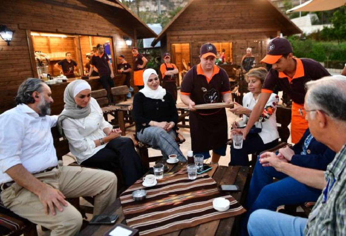 Young Syrians with Down Syndrome work at a cafe called Sucette in the capital Damascus on Aug. 21, 2021.