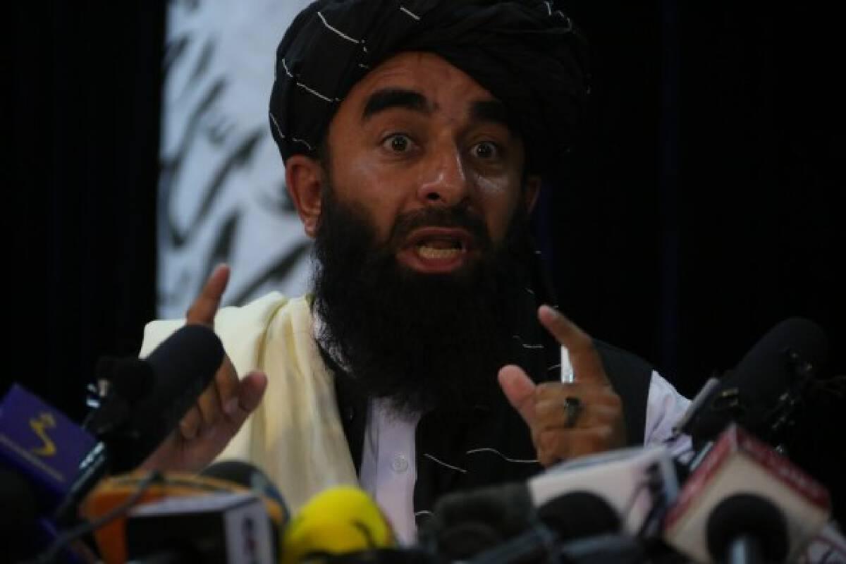 Taliban spokesman Zabihullah Mujahid addresses a press conference in Kabul, capital of Afghanistan, on Aug. 17, 2021.