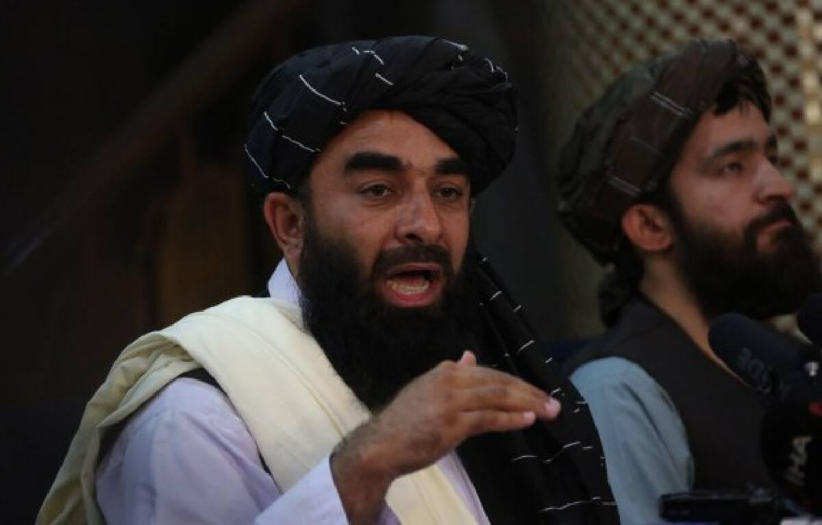 Taliban spokesman Zabihullah Mujahid (L) addresses a press conference in Kabul, capital of Afghanistan, on Aug. 17, 2021.