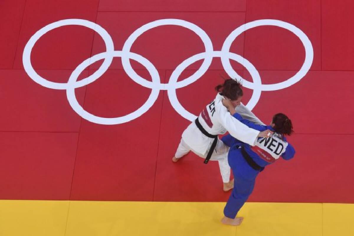 Theresa Stoll (white) of Germany competes with Sanne Verhagen of Netherlands during the Judo mixed team bronze medal match between Germany and Netherlands at Tokyo 2020 Olympic Games in Tokyo, Japan, on July 31, 2021.