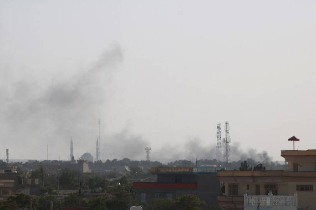 Photo taken on Aug. 6, 2021 shows smoke rising during gun fights in Shiberghan, capital of Jawzjan Province, Afghanistan.