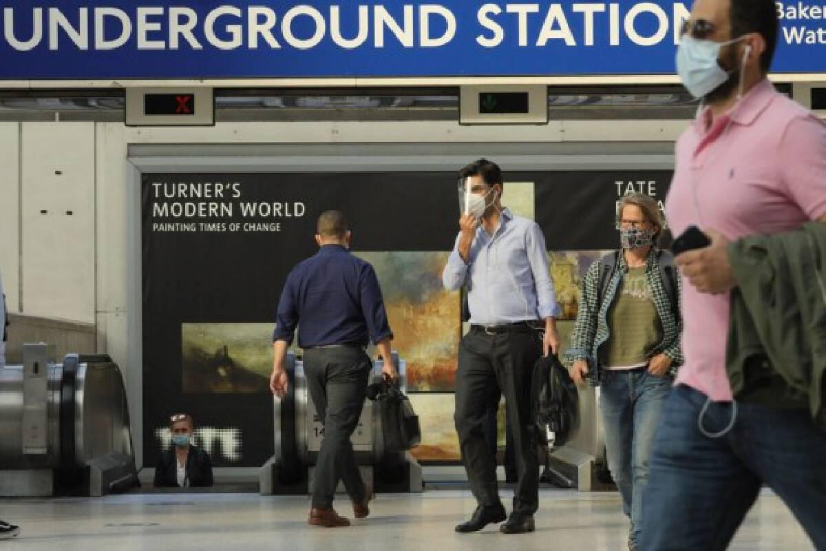 Passengers walk at Waterloo train station in London, Britain, on Aug. 5, 2021.