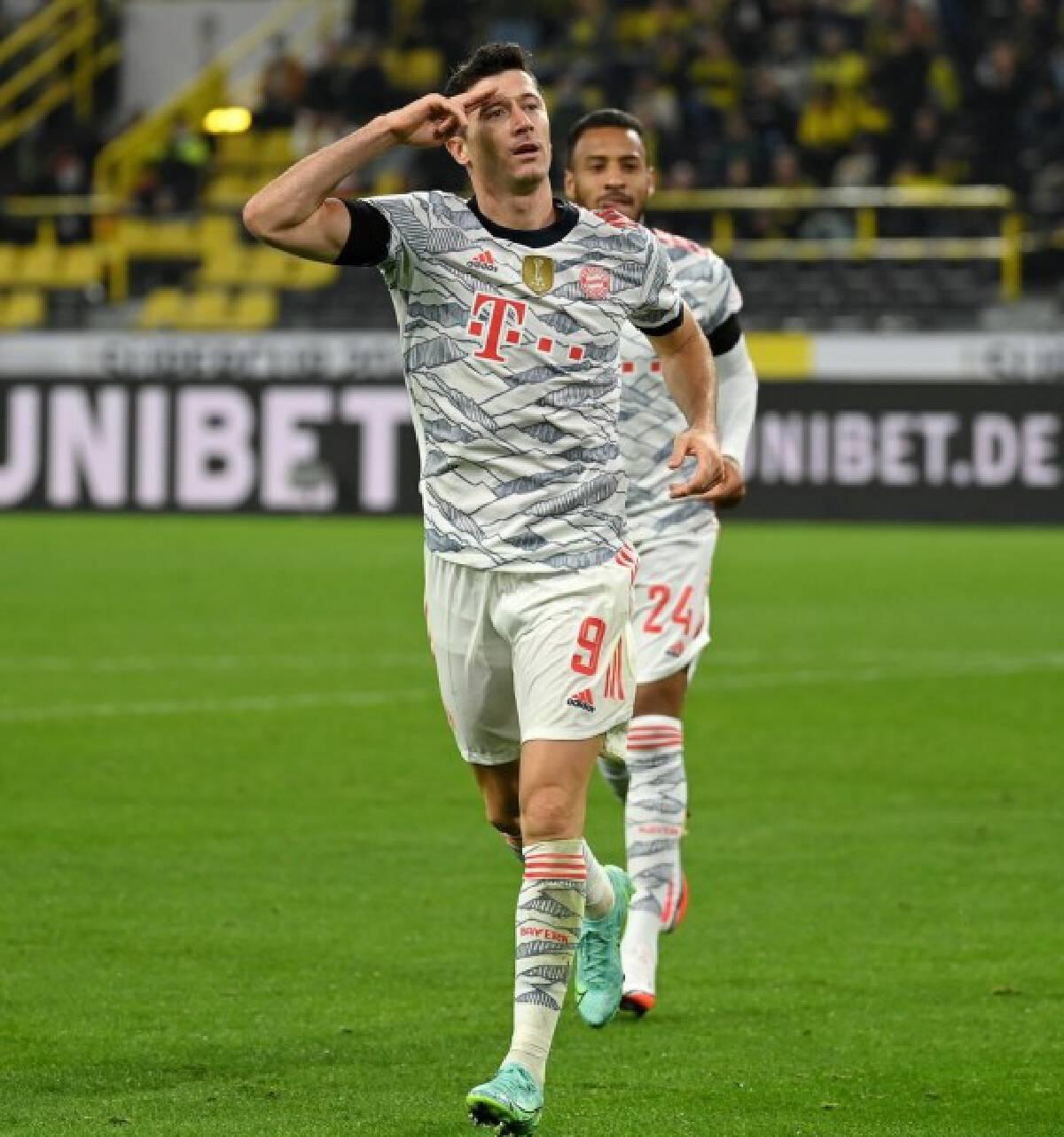 Robert Lewandowski (front) of Bayern Munich celebrates scoring during their German Supercup tie against Borussia Dortmund in Dortmund, Germany, Aug. 17, 2021.