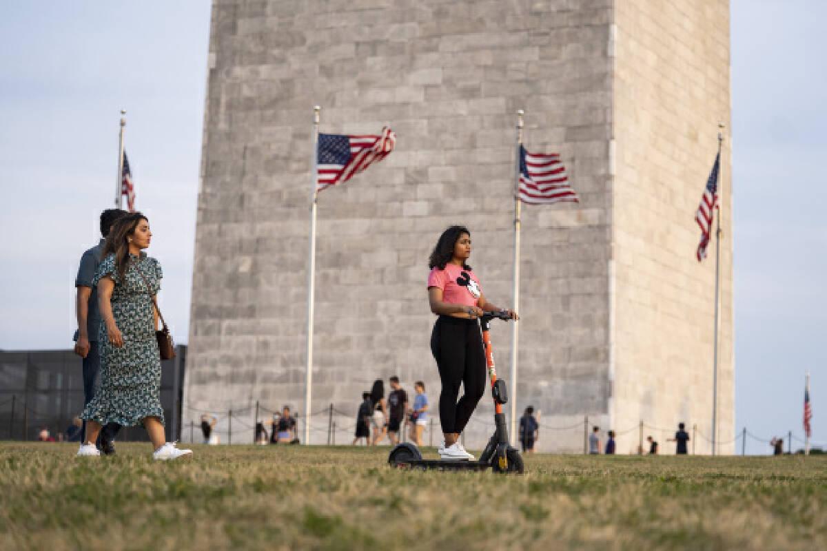 People visit the Washington Monument in Washington, D.C., the United States, on Aug. 6, 2021.