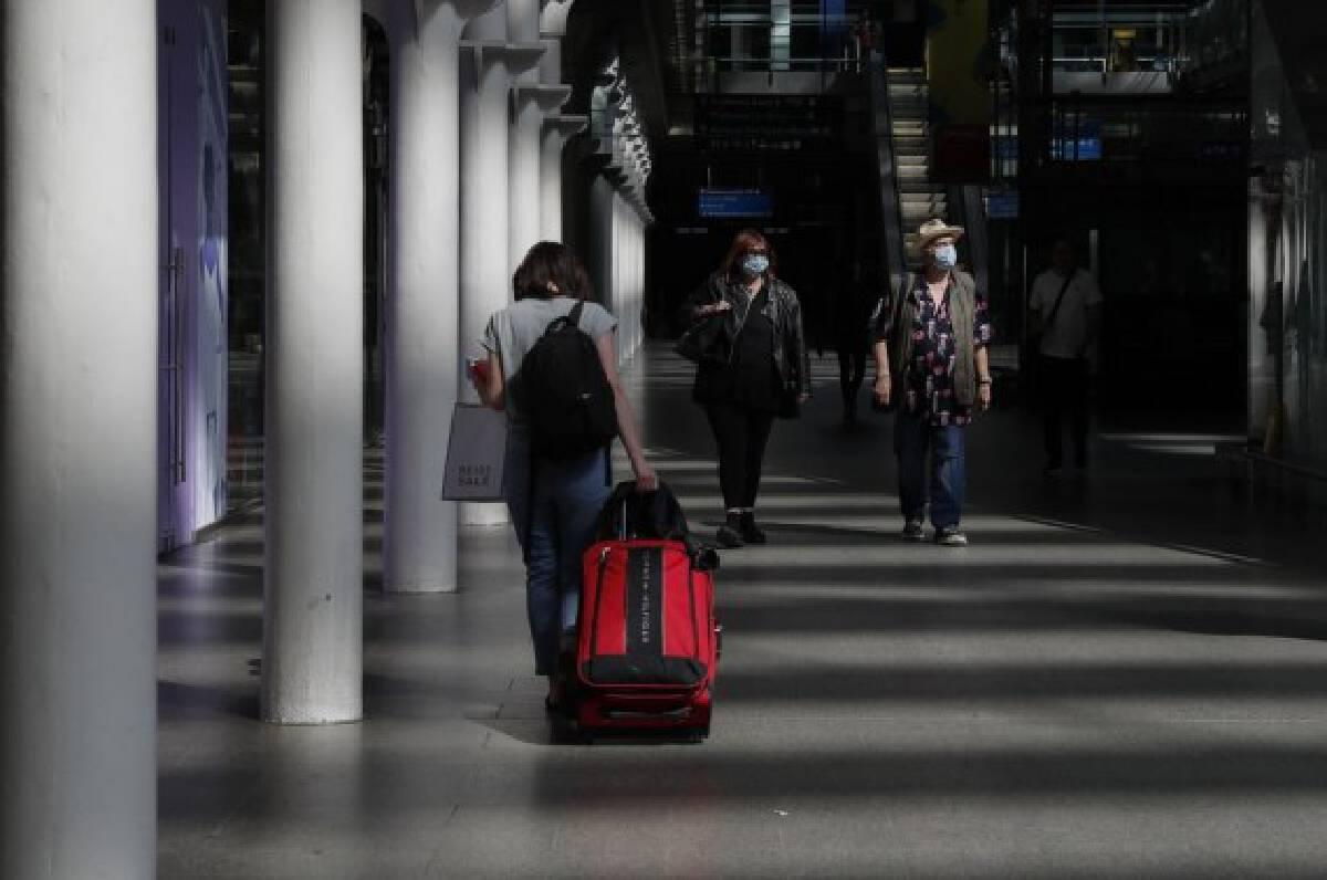 Passengers walk at St. Pancras International Station in London, Britain, July 29, 2021.