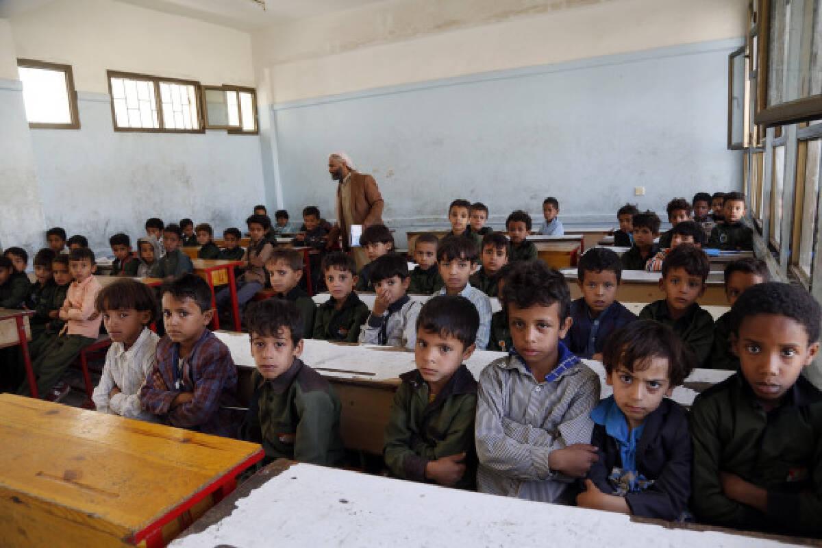 Children attend a class at a school in Sanaa, Yemen, on Sept. 8, 2021.