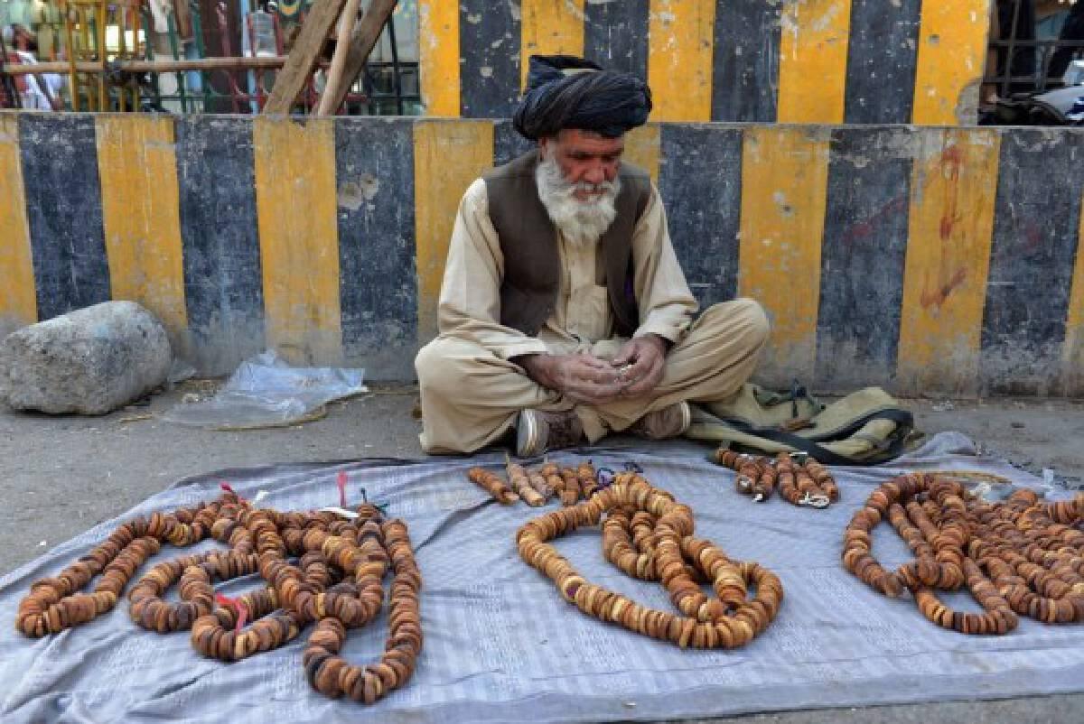 An Afghan vendor waits for consumers in Kandahar city, southern Afghanistan, Sept. 14, 2021. (Photo by Sanaullah Seiam/Xinhua)