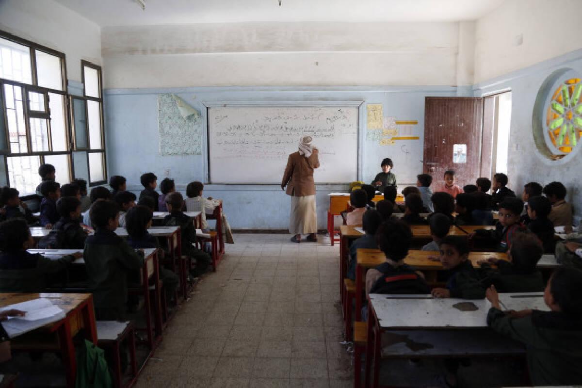 Children attend an Arabic class at a school in Sanaa, Yemen, on Sept. 8, 2021.