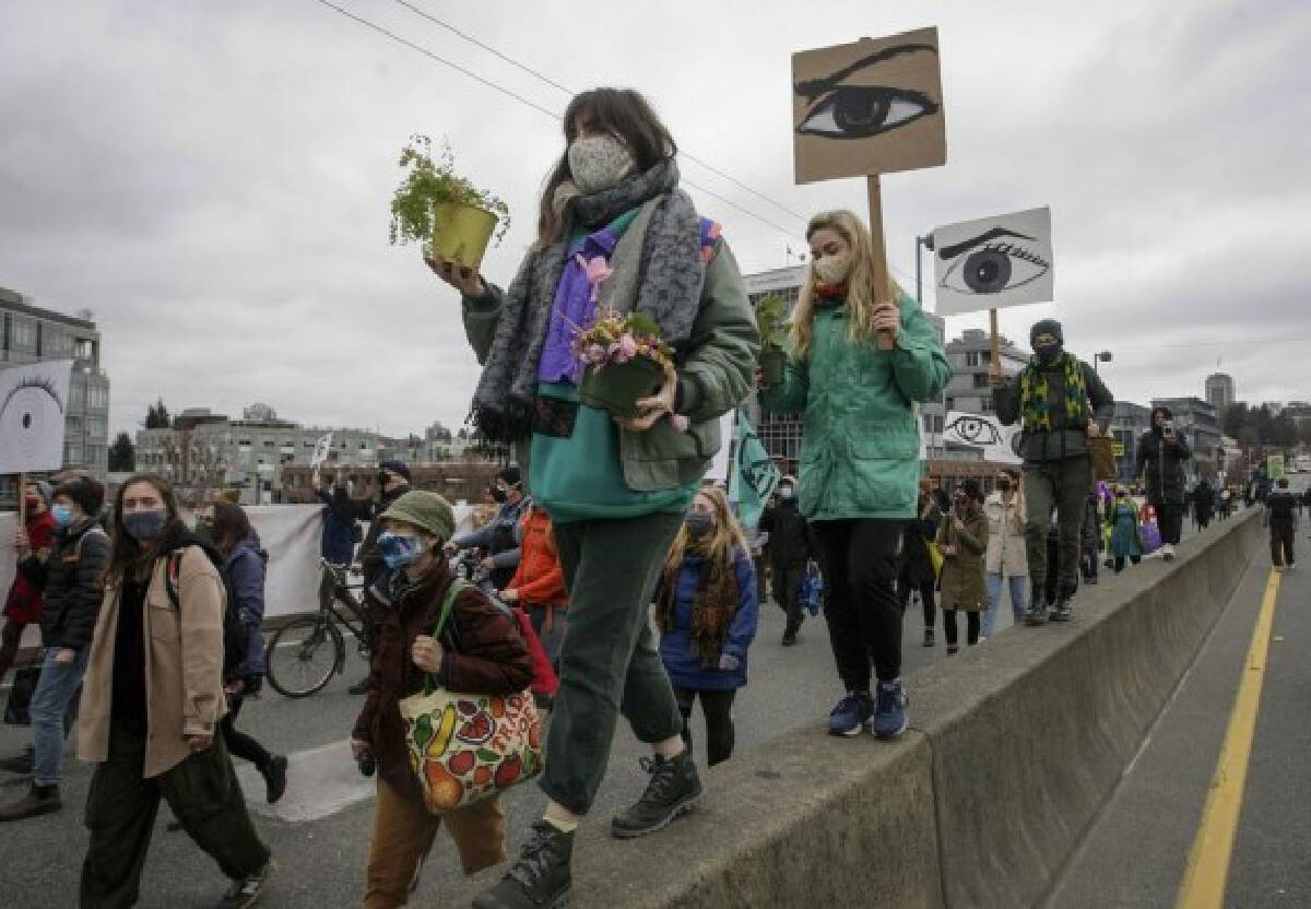 People march during a climate change protest in Vancouver, British Columbia, Canada, on March 27, 2021. (Photo by Liang Sen/Xinhua)