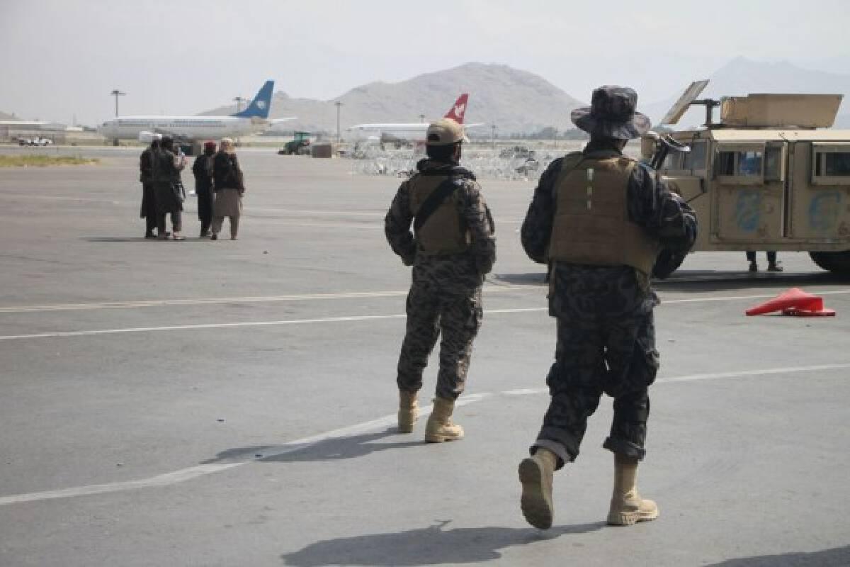 Taliban members are seen at Kabul airport in Kabul, capital of Afghanistan, Aug. 31, 2021.