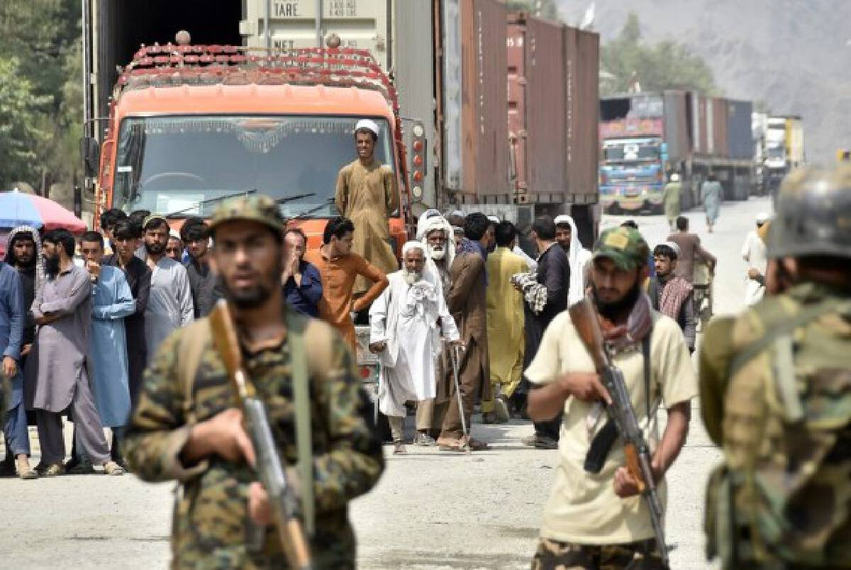 Afghan people are seen on Afghan side of the border near the border crossing point of Torkham between Pakistan and Afghanistan on Sept. 5, 2021.