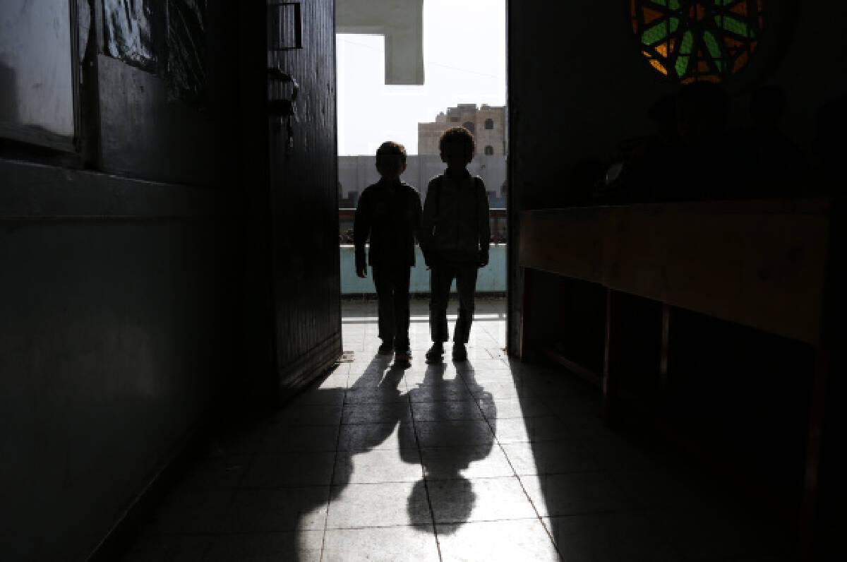 Two school children are seen at a school in Sanaa, Yemen on Sept. 8, 2021.