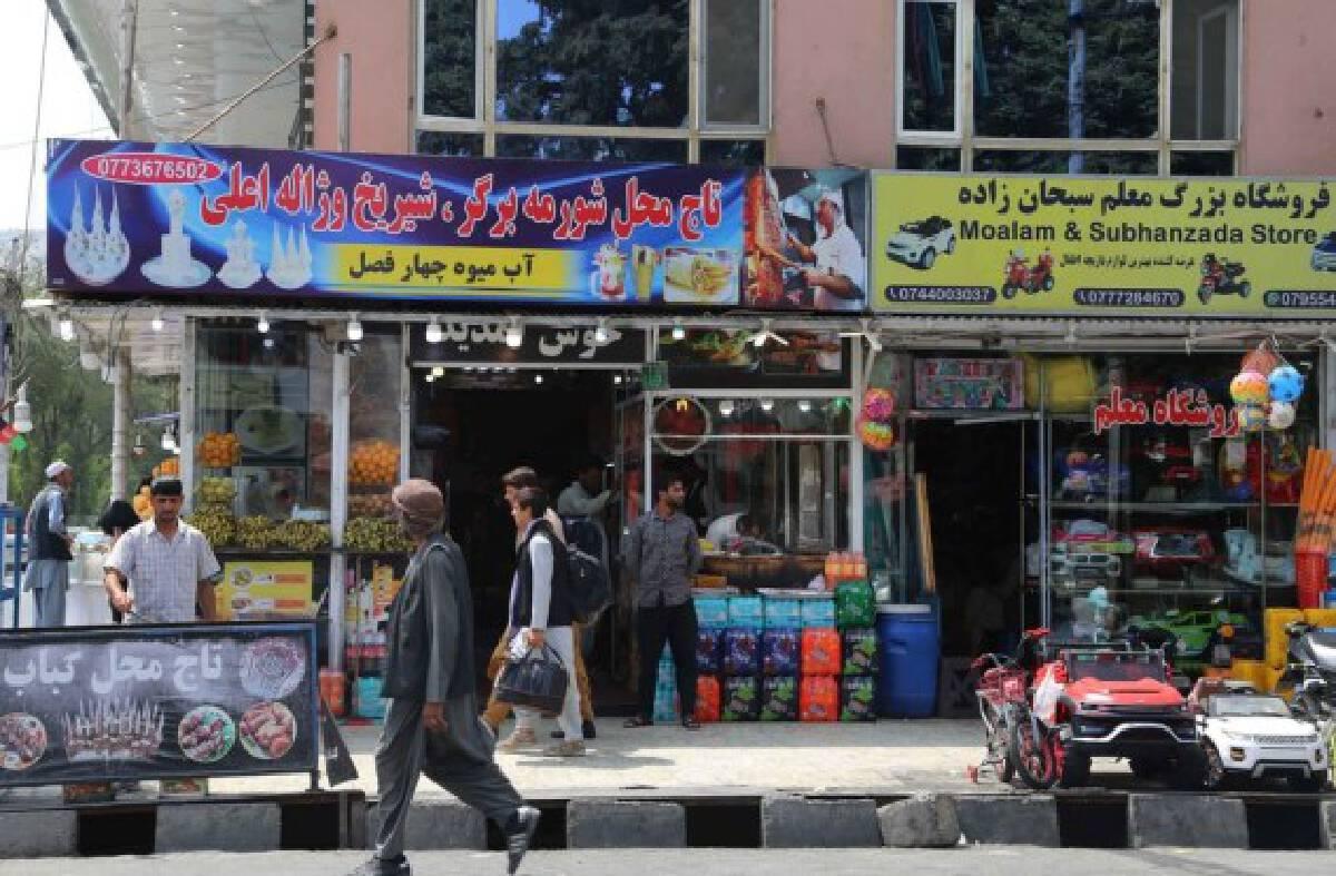 People walk on the street in Kabul, capital of Afghanistan, Aug. 31, 2021.